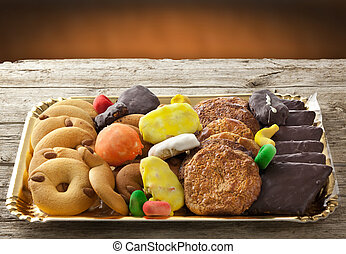 Mix of pastries and cookies in the tray.