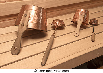 Finnish sauna - Two buckets for water with ladles in an...