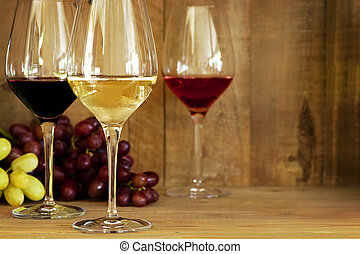 Wine Glasses and Grapes - Wine glasses with grapes, against...