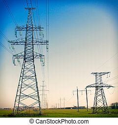 Electricity pylon against blue cloudy sky. Vintage - Super...