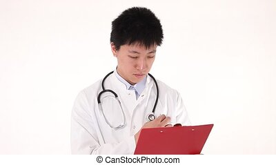 Young asian doctor writing on his c