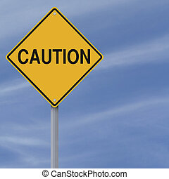 Caution Sign - A warning sign against a blue sky background...