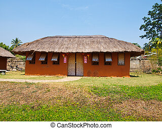 An adobe house on green field and blue sky in Pai, Mae hong...