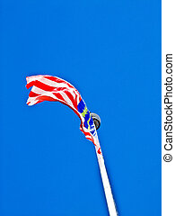 Malaysia flag flew over the blue sky
