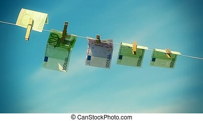 Euro banknotes hanging on rope in wind on a blue sky...