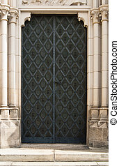 Black Cathedral Door in White Stone