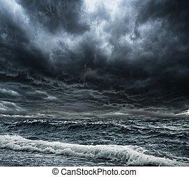 Big ocean wave breaking the shore - Dark stormy sky over...