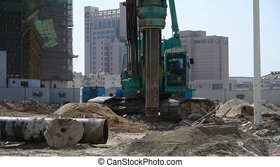 drill machinery drilling in land,Construction site.
