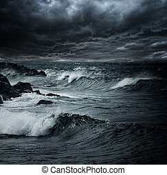 Dark stormy sky over ocean with big waves