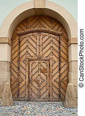 Wooden Church Door within Door - Detail of a brown wooden...