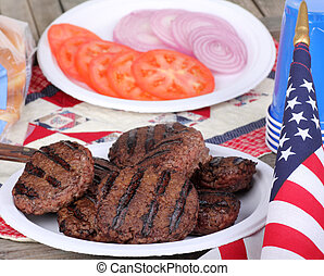 4th of July Burgers - Grilled hamburgers on a plate with...