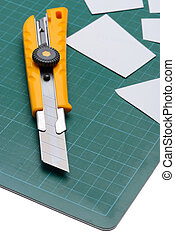 Box Cutter Knife just Cutting white paper on cutting mat...