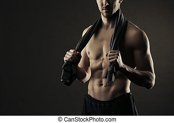 Fitness - Muscular, shirtless man with towel around neck