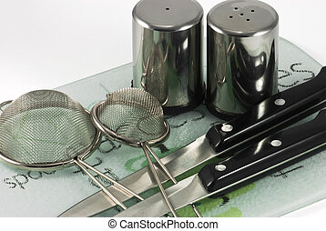 Utensils on ceramic tiles - Kitchen utensils of stainless...