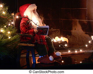 santa clause - model santa clause sitting beneath a fire...