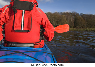 Kayaking on Lake Windermere in Lake District England
