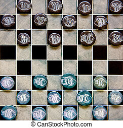 checkers pieces - checkers game pieces made of ceramic on a...