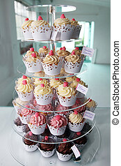 Elegant cupcakes exposed in a confectionery - Elegant...