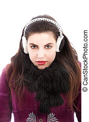 Cold woman wearing ear muffs