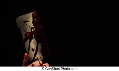 Bloody Hatchet - Male hand covered in blood popping up in...