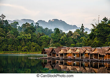 Bamboo huts floating in a Thai village, Cheow Lan Lake, Khao...
