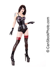 Fetish woman wearing latex outfit and high heels, isolated...