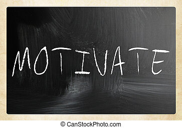 """Motivate"" handwritten with white chalk on a blackboard"