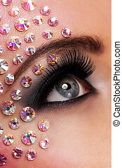 Closeup image of eyes with diamond makeup - Closeup image of...