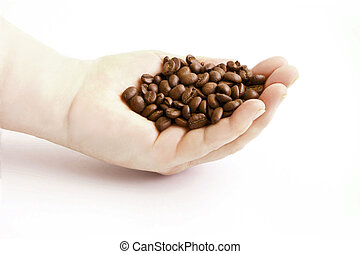 Grains of coffee on a palm