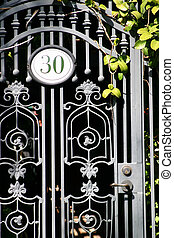 Door 30 - Iron door with the number 30 and some green