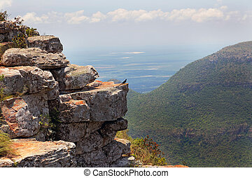 Rocky ledge overlooking a mountain valley - Rocky ledge...