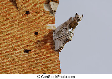 Gargoyle in Pisa - Gargoyle on a brick building in Pisa,...