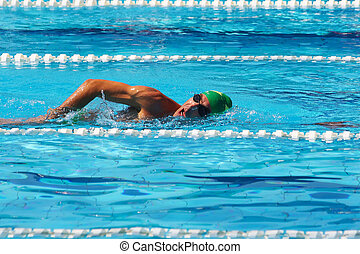 Swimmer crowls in pool 3 - Muscular swimmer crowls in pool...