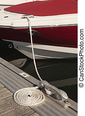 Mooring - Detail of a floating dock with mooring bitts