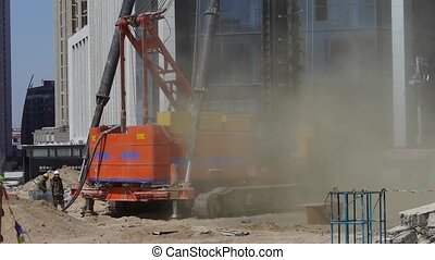 drill machinery working in Construction site raising the...