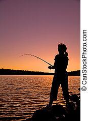 Woman Fishing at Sunset