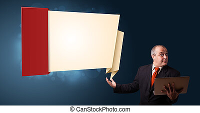 Businessman in suit holding a laptop and presenting modern origami copy space