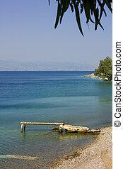 The wooden bridge on sea beach