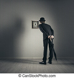 Curiosity - Businessman looking through keyhole