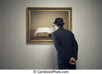 Education - Elegant man looking at a book with blank pages