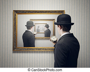 Time concept - A man holding an alarm clock