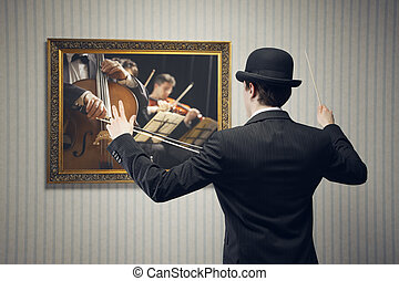 Concert conductor - Male orchestra conductor directing with...
