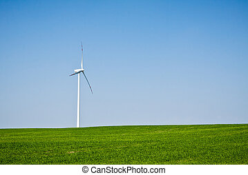 Wind turbine on green field