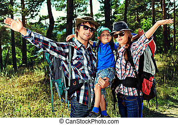 cheerful family - Happy parents hiking with their little son...