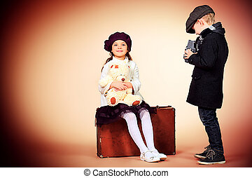 imagine - Cute little boy is photographing the charming...