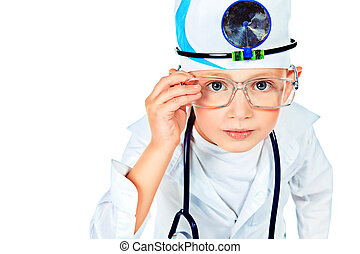peering - Portrait of a cute boy playing doctor with a...