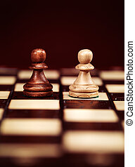 Two pawns on chessboard - Two pawns chess pieces on a...