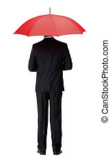 Back view of man in suit with umbrella
