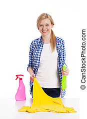 Young woman cleaning stained shirt