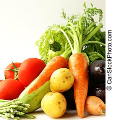 fresh spring vegetables - carrots, tomatoes, asparagus,...